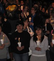 Mourners hold candles during a vigil for Amber Dubois at Escondido High School on March 8, 2010.