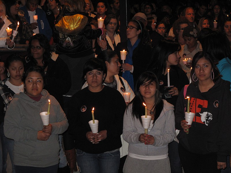 Mourners hold candles during a vigil for Amber Dubois at Escondido High Schoo...