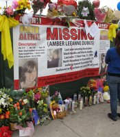 Community members place flowers on a memorial for Amber Dubois at Escondido High School on March 8, 2010.