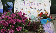Friends of Amber Dubois leave messages and poems of love and support at a mak...