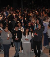 A crowd listens to family tributes during a candlelight vigil in memory of 14-year-old Amber Dubois at Escondido High School on March 8, 2010.