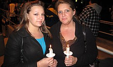 Shawnda Allen and her daughter Kayla McKemie attend a candlelight vigil in me...