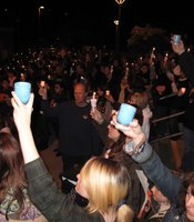 "Following the tributes at a candlelight vigil for slain 14-year-old Amber Dubois, the crowd held up candles and began singing ""Amazing Grace"" at Escondido High School on March 8, 2010."