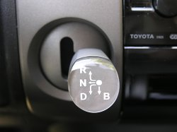 The gear shift in a Toyota Prius. Auto safety experts recommend shifting into...