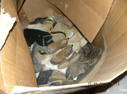 Dirty sneakers and work boots were found inside of the building where the tun...