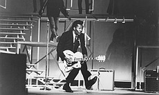 "Chuck Berry performs on stage for ""The T.A.M.I. Show."""