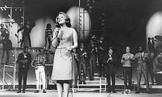 "Lesley Gore performs on stage for ""The T.A.M.I. Show."""