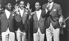 "Smokey Robinson and the Miracles perform on stage for ""The T.A.M.I. Show."""
