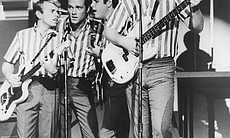 "The Beach Boys perform on stage for ""The T.A.M.I. Show."""