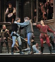 (L-R) American tenor Joel Sorensen (Tybalt) and American baritone David Adam Moore (Mercutio) are locked in deadly swordplay while American tenor Stephen Costello (Romeo) attempts to separate them.