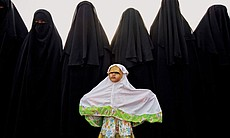 Facing the dawn, women of the An-Nadzir commune begin Islam's Feast of the Sa...