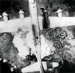 A B-29 Superfortress, the most advanced bomber in the world, drops fire bombs on Kobe, Japan's major port, in March 1945. The raids began the night of March 9 when B-29s incinerated a quarter of Tokyo, killing as many as 100,000 civilians.