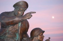A 12-foot-tall bronze sculpture was created to honor the Navy's efforts on D-...