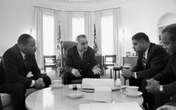 President Lyndon B. Johnson meets with Civil Rights leaders Martin Luther King, Jr., Whitney Young and James Farmer on January 18, 1964.