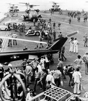 "At times it was ""controlled chaos"" on the USS Midway's flight deck as some sailors escorted refugees below while others cleared the flight deck to make room for inbound choppers.  More than 3,000 refugees landed on the Midway in little more than 24 hours."