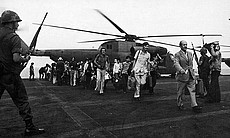 Many South Vietnamese refugees arrived on the USS Midway with a single suitca...