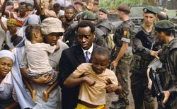 Paul (Don Cheadle) risks his own life to house Tutsi refugees at the hotel he manages.