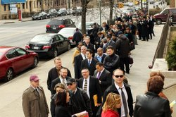 Job seekers wait on line to attend a UJA-Federation of New York job fair on M...