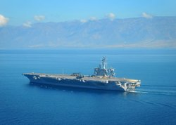 PORT-AU-PRINCE, Haiti (Jan. 18, 2010) The Nimitz-class aircraft carrier USS C...