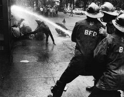 In May 1963, firefighters turn their hoses full force on young civil rights d...