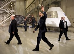 U.S. President Barack Obama (C) waves after speaking at the Operations and Checkout Building at NASA Kennedy Space Center April 15, 2010 in Cape Canaveral, Floridia. Obama is holding a summit to discuss the future of the space program.