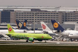 Planes stand in their positions at Frankfurt International Airport on April 1...