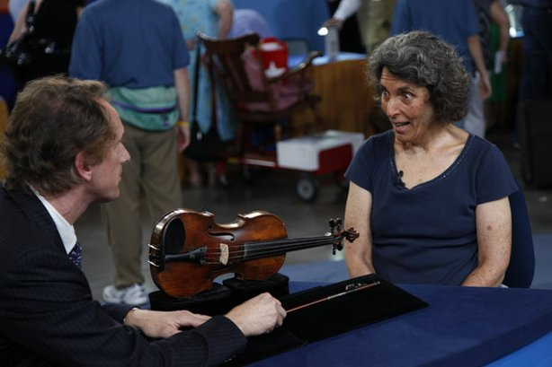 "At ""Antiques Roadshow"" in Phoenix, Arizona, this guest brings in a violin made by the Gagliano family in Naples in the early 1800s and a violin bow made in France in the shop of Jean-Baptiste Vuillaume. Appraiser David Bonsey estimates the pair to be worth between $72,000 and $94,000."