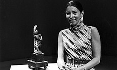 Gloria Penner with Asian artifact in 1972.