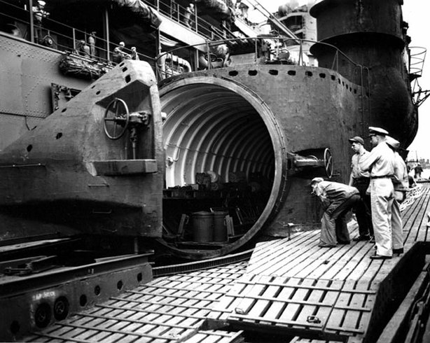 U.S. Navy personnel inspect the I-400's huge watertight hangar. With missions to attack U.S. cities and blow up the Panama Canal, the Japanese aircraft carrier submarine had the potential to change the course of the war in the Pacific.