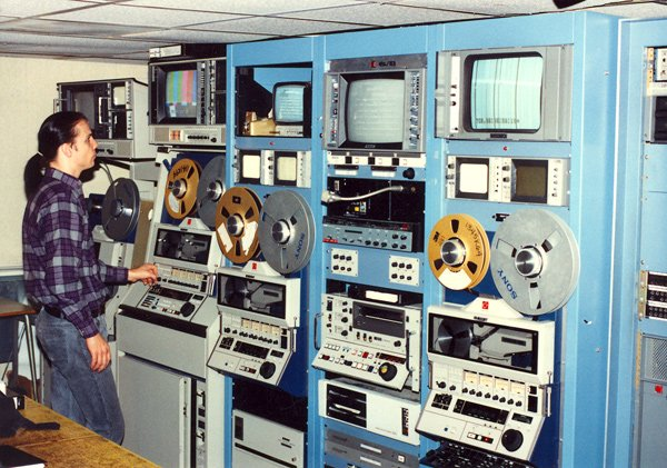 Until recently, television programs were typically recorded from satellite feeds and later played back from tape machines such as this one.  Technological advances now enable KPBS to record and broadcast programs via computerized servers.