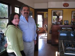 Felipe and Teresina Hueso stand in the kitchen of their Sherman Heights home.