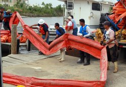 Workers load oil booms onto a boat as the effort continues to try and contain the massive oil spill in the Gulf of Mexico on May 1, 2010 in St Bernard Parish, Louisiana.