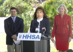 Debra Zanders-Willis, center, Director, County of San Diego Health and Human Services Agency (HHSA) Child Welfare Services, talks about the resources available to parents and caretakers to prevent or stop child abuse. Also: Nick Macchione, left, Director, HHSA, and Chairwoman Pam Slater-Price, right, County of San Diego Board of Supervisors.
