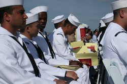 Sailors and Marines take the oath of U.S. citizenship on the USS Midway on May 13, 2010.