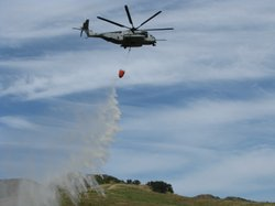 A CH 53 Super Stallion Marine helicopter picks up water to do a water drop as part of a joint aerial firefighting exercise with Cal Fire on Camp Pendleton on May 13, 2010.