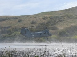 A CH 46 SeaKnight helicopter picks up water from Lake Pulgas on Camp Pendleton in preparation to do a water drop on May 13, 2010. The maneuver was part of a joint exercise with CalFire.