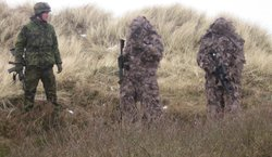 Danish soldiers in camouflage suits.