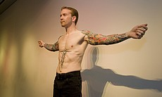 A model displays his tattoo sleeves during the Masterworks of Body Art runway show.