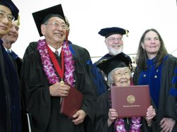 Carl Yoshimine (right) and June Kushino (left) stand with top-ranking San Diego State University officials on Monday after receiving their honorary degrees on May 17, 2010. Yoshimine and Kushino were denied a college education at San Diego State in 1942 after they were forced into American internment camps.