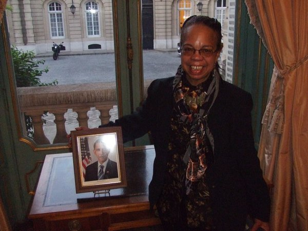 Professor Bennetta Jules-Rosette at the U.S. Embassy in Paris with (a framed picture of) President Obama.