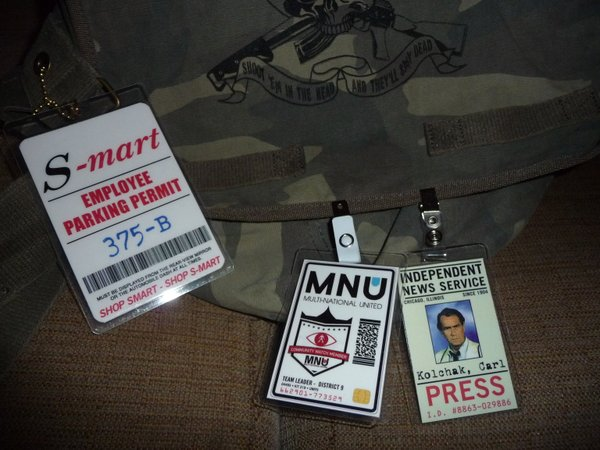 "Geek fun... an employee parking permit from ""Army of Darkness,"" and I.D. badges for M.N.U. (from ""District 9"") and Independent News Service (form ""Kolchak: The Night Stalker"")."