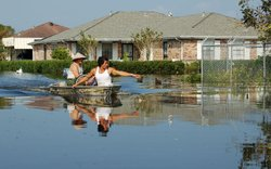 Residents of Versailles return to their neighborhood to check out the damage following Hurricane Katrina, 2005.