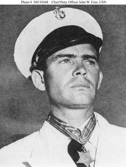 Chief Aviation Ordnanceman John William Finn was awarded the Medal of Honor for extraordinary heroism and distinguished service during the December 7, 1941 Japanese air attack on Naval Air Station Kanoehe Bay, Oahu, T.H. He is wearing the medal in this photograph.