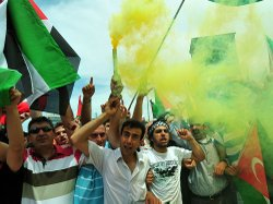 Turkish demonstrators wave Palestinian flags and shout slogans during an anti-Israeli protest Monday on Taksim Square in Istanbul.