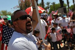 Opponents of Arizona's new immigration enforcement law protest outside the state capitol building on April 25, 2010 in Phoenix, Arizona.