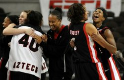The Lady Aztecs celebrate their upset win.