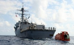 In this photo provided by the U.S. Navy, the guided-missile destroyer USS Bainbridge tows the lifeboat from the Maersk Alabama to be processed for evidence after the successful rescue of Capt. Robert Phillips April 13, 2009 in the Indian Ocean.