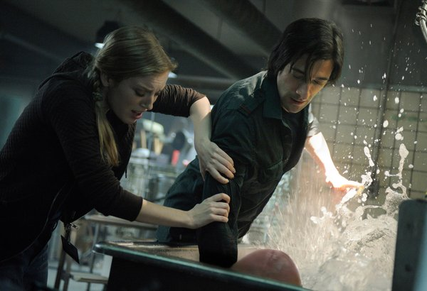 "Sarah Polley and Adrien Brody play scientists in ""Splice"""