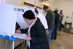 A woman votes at a polling place in California, 2010.