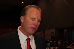San Diego City Councilman Kevin Faulconer talks to supporters about the passa...